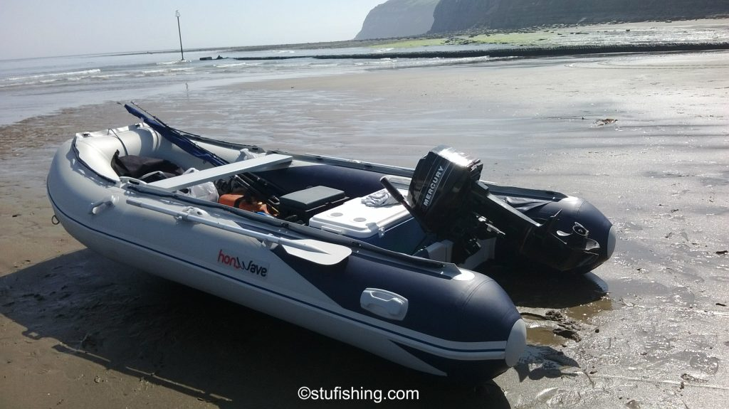 The Honda Honwave T40-AE Inflatable Boat garden side view at beach skinningrove